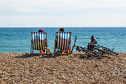 © Licensed to London News Pictures. 14/06/2020. Brighton, UK. Members of the public take to the beach in Brighton and Hove aswarm and sunny weather is hitting the seaside resort. Photo credit: Hugo Michiels/LNP