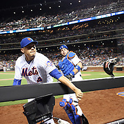 NEW YORK, NEW YORK - June 14:  Third baseman Wilmer Flores #4 of the New York Mets fails to get to a pop up from Jung Ho Kang #27 of the Pittsburgh Pirates as he loses both the ball and his glove into the camera dugout on the third base line as catcher Kevin Plawecki #26 of the New York Mets looks on during the Pittsburgh Pirates Vs New York Mets regular season MLB game at Citi Field on June 14, 2016 in New York City. (Photo by Tim Clayton/Corbis via Getty Images)
