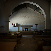 January 21, 2013 - Diabaly, Mali: General view of the inside of a destroyed catholic church in central Diabaly, a day after Mali government troops regain control of the city. Diabaly was under islamist militants control since the 14th of January...Several insurgent groups have been fighting a campaign against the Malian government for independence or greater autonomy for northern Mali, an area known as Azawad. The National Movement for the Liberation of Azawad (MNLA), an organisation fighting to make Azawad an independent homeland for the Tuareg people, had taken control of the region by April 2012...The Malian government pledge to the French army to help the national troops to stop the rebellion advance towards the capital Bamako. The french troops started aerial attacks on rebel positions in the centre of the country and deployed several hundred special forces men to counter attack the advance on the ground. (Paulo Nunes dos Santos/Polaris)