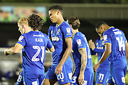 AFC Wimbledon defender Toby Sibbick (20) celebrating after scoring goal to make it 3-3 during the EFL Trophy match between AFC Wimbledon and Tottenham Hotspur at the Cherry Red Records Stadium, Kingston, England on 3 October 2017. Photo by Matthew Redman.
