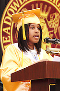 Salutatorian Kelli Williamson speaks during the Meadowdale High School commencement in their gym in Dayton, Tuesday, May 22, 2012.