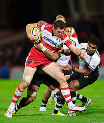 Gloucester Inside Centre (#12) Tim Molenaar is tackled during the second half of the match - Photo mandatory by-line: Rogan Thomson/JMP - Tel: Mobile: 07966 386802 13/11/2012 - SPORT - RUGBY - Kingsholm Stadium - Gloucester. Gloucester Rugby v Fiji - International Friendly