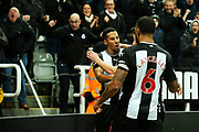 Isaac Hayden (#14) of Newcastle United celebrates Newcastle United's first goal (1-0) as the corner flag, kicked by Matt Ritchie (#11) of Newcastle United flies into the stand and strikes a Newcastle United supporter during the Premier League match between Newcastle United and Chelsea at St. James's Park, Newcastle, England on 18 January 2020.
