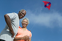 Middle-Aged Couple Flying Kite