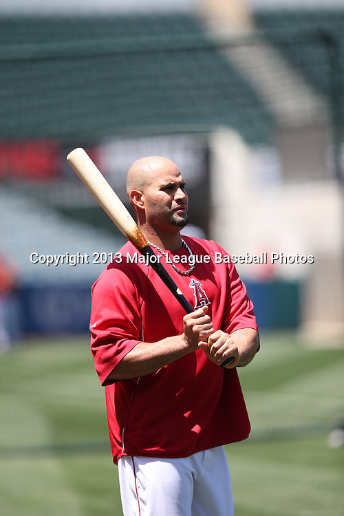 ANAHEIM, CA - JUNE 15:  Albert Pujols #5 of the Los Angeles Angels of Anaheim watches batting practice before the game against the New York Yankees on Saturday, June 15, 2013 at Angel Stadium in Anaheim, California. The Angels won the game 6-2. (Photo by Paul Spinelli/MLB Photos via Getty Images) *** Local Caption *** Albert Pujols