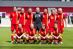 LLANELLI, WALES - Monday, August 19, 2013: Wales players line up for a team group photograph before the opening Group A match against Denmark of the UEFA Women's Under-19 Championship Wales 2013 tournament at Parc y Scarlets. Back row L-R: Alys Hinchcliffe, Amy Thrupp, Hannah Keryakoplis, goalkeeper Alice Evans, Rhian Cleverly, Emma Beynon, captain Lauren Price. Front row L-R: Rachel Hignett, Lauren Hancock, Ellie Curson, Angharad James. (Pic by David Rawcliffe/Propaganda)