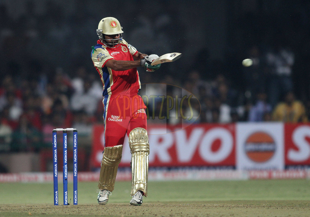 Mohammad Kaif of Royal Challengers Bangalore pulls a delivery to the boundary during match 1 of the NOKIA Champions League T20 ( CLT20 )between the Royal Challengers Bangalore and the Warriors held at the  M.Chinnaswamy Stadium in Bangalore , Karnataka, India on the 23rd September 2011..Photo by Shaun Roy/BCCI/SPORTZPICS