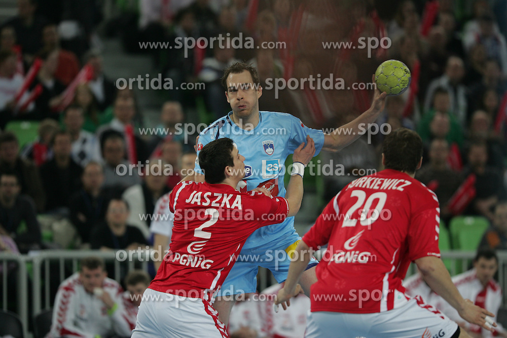 Bartlomiej Jaszka (POL) and Jure Natek (Slo) at handball match between National teams of Slovenia and Poland of Qualifications for EURO 2012, on March 9, 2011 in Arena Stozice, Ljubljana, Slovenia. (Photo By Vid Ponikvar / Sportida.com)