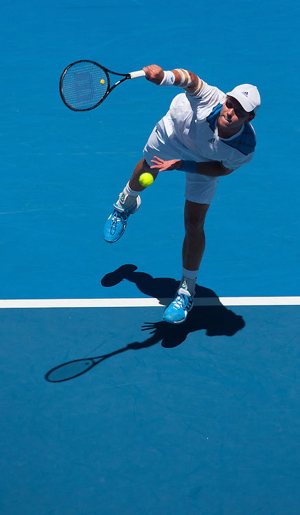 James Duckworth (AUS) during play in Day 2 of Australian Open play as temperatures soared to 43C, 109.4F . R. Federer (SUI) beat Duckworth 6-4, 6-4,6-2 in first round play of the 2014 Australian Open at Melbourne's Rod Laver Arena.
