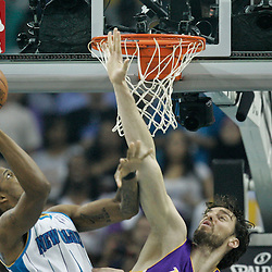 April 24, 2011; New Orleans, LA, USA; New Orleans Hornets small forward Trevor Ariza (1) shoots over Los Angeles Lakers power forward Pau Gasol (16) during the first quarter in game four of the first round of the 2011 NBA playoffs at the New Orleans Arena.    Mandatory Credit: Derick E. Hingle