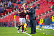 Heart of Midlothian manager Craig Levein discusses tactics with his captain, Christophe Berra (#6) of Heart of Midlothian FC after Hearts score a goal during the William Hill Scottish Cup semi-final match between Heart of Midlothian and Inverness CT at Hampden Park, Glasgow, United Kingdom on 13 April 2019.