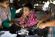 The sons of Ko Aung Mgo tasting the freshly made sugar. At Ka Myaw Gyi village in the outskirts of Dawei, Myanmar.