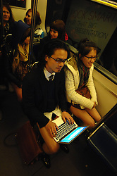 Hiroki Mori works on his laptop on Vancouver s SkyTrain during the No Pants Subway Ride, Canada, Jan. 13, 2013. Hundreds of people bared their legs during the 4th annual No Pants Subway Ride on Sunday in Vancouver, Canada, January 13, 2013. Photo by Imago / i-Images...UK ONLY