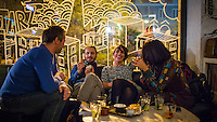 Rome, Italy - December 12, 2014: A group of friends share a laugh at Yeah Pigneto, in the hip neighborhood that shares the same name in Rome. CREDIT: Chris Carmichael for The New York Times
