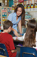 Teacher with school boy and school girl