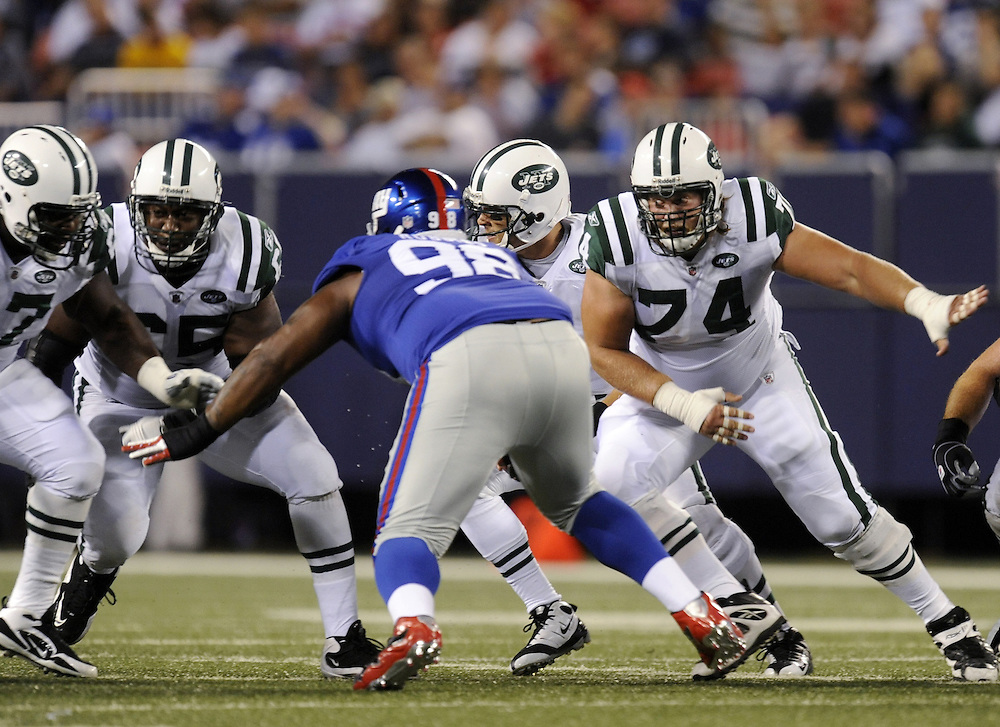 EAST RUTHERFORD, NJ - AUGUST 29: Nick Mangold #74 and Brandon Moore #65 of the New York Jets block against Fred Robbins #98 of the New York Giants in a preseason game at Giants Stadium on August 29, 2009 in East Rutherford, New Jersey. The New York Jets beat the New York Giants 27-25. (Photo by Rob Tringali) *** Local Caption *** Nick Mangold; Brandon Moore;Fred Robbins