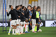 Juventus's Portuguese striker Cristiano Ronaldo throws an object as the two teams and officials line up before kickoffk off during the Serie A match at Allianz Stadium, Turin. Picture date: 26th June 2020. Picture credit should read: Jonathan Moscrop/Sportimage