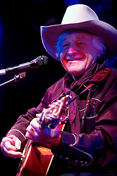 17  December, 05. Tipitina's, New Orleans, Louisiana.<br />  Arlo Guthrie and friends Riding on the city of New Orleans tour benefiting Musicares Hurricane relief 2005 sponsored by Amtrak. As yet unidentified musician on stage.<br /> Photo; ©Charlie Varley/varleypix.com