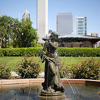 The Dove Girl fountain statue in Grant Park in Chicago. The Dove Girl Fountain is one of several sculptures in Chicago's Grant Park. The photo is vertical, high resolution and was taken in May 2010.