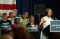 First Lady Michelle Obama addresses the audience at the Laconia Middle School on Thursday afternoon.  (Karen Bobotas/for the Laconia Daily Sun)