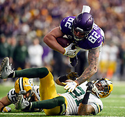 Minnesota Vikings tight end Kyle Rudolph (82) is upended by Green Bay Packers free safety Ha Ha Clinton-Dix (21) during a game on Sunday at U.S. Bank Stadium in Minneapolis. (Matt Gade / Republic)