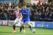 AFC Wimbledon defender Callum Kennedy (23) battles for possession with Lincoln City defender Neil Eardley (23) during the The FA Cup match between AFC Wimbledon and Lincoln City at the Cherry Red Records Stadium, Kingston, England on 4 November 2017. Photo by Matthew Redman.