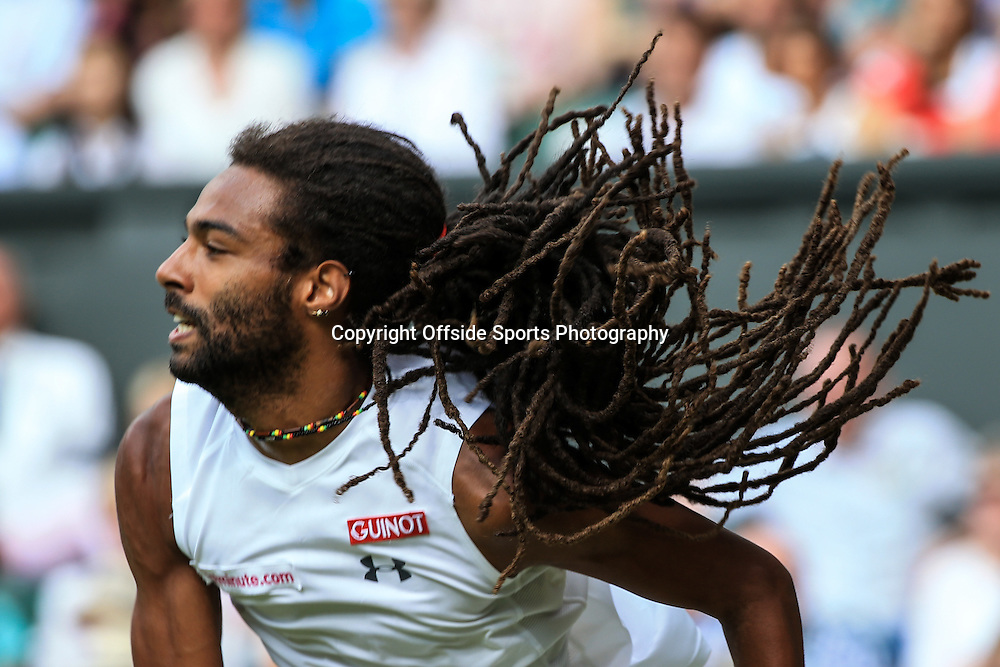2 July 2015 - Wimbledon Tennis (Day 4) - Dreadlocks fly as Dustin Brown (GER) serves - Photo: Marc Atkins / Offside.