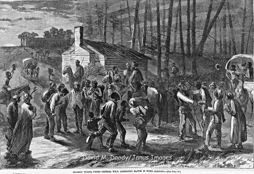 General Wild's Colored troops liberating slaves.   Raid in North Carolina on the plantation of Mr Terrebee in Camden County.  Civil War 1864 Black Soldiers; African-Americans Harper's Weekly