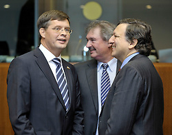 "Jan Peter Balkenende, the Netherlands's prime minister, left, speaks with Jean Asselborn, Luxembourg's foreign minister, center, and Jose Manuel, Barroso, president of the European Commission, during the European Union Summit at the EU headquarters in Brussels, Belgium, on Thursday, Oct. 29, 2009. European Union leaders are set for ""very difficult"" talks to overcome the Czech Republic's resistance to a new governing treaty designed to strengthen the EU's influence in world affairs, Reinfeldt said. (Photo © Jock Fistick)"