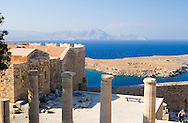 A view of columns and the sea from The Acropolis, Lindos, Rhodes, Dodecanese Islands, Greece