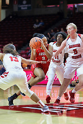 NORMAL, IL - December 04: Nieja Crawford cuts to the paint between Katrina Beck and Lexy Koudelka during a college women's basketball game between the ISU Redbirds  and the Austin Peay Governors on December 04 2018 at Redbird Arena in Normal, IL. (Photo by Alan Look)