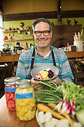 Jason French, chef and owner of Ned Ludd, an American craft kitchen in Portland, Oregon, shows off his radish, cauliflower and beet pickles, a specialty of the restaurant.