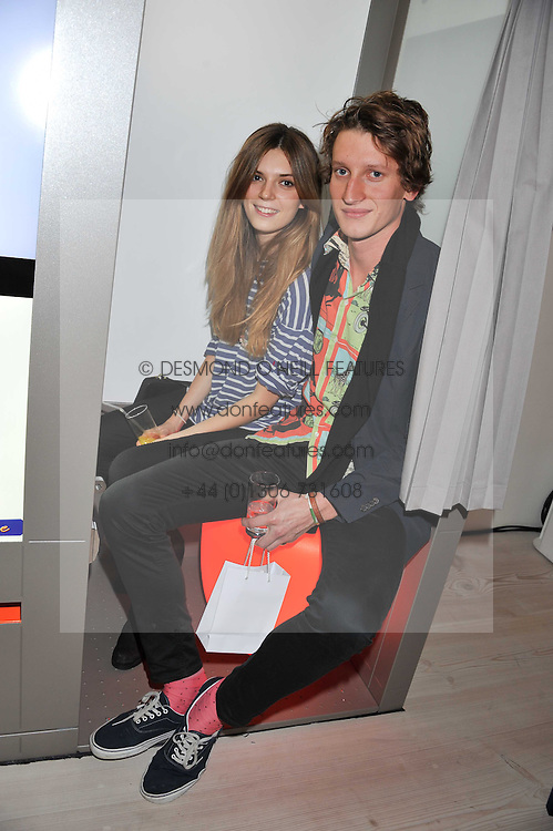 "FREDDIE PAGE and OLIVIA DUNIN at the launch of ""Photo-Me by Starck"" – a photobooth exclusively designed by the world renowned artist and creator Philippe Starck held at The Saatchi Gallery, Duke Of York Square, Kings Road, London on 2nd November 2011."