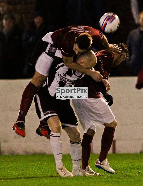 Linlithgow defender Colin Leiper clears from Wick striker Gary WEir in tonights William Hill Scottish CUp match at Prestonfield