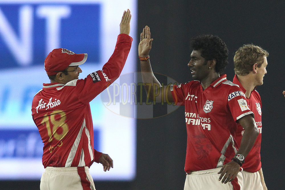 Virender Sehwag of the Kings XI Punjab congratulates Parvinder Awana of the Kings XI Punjab for getting Dilshan Munaweera of the Barbados Tridents wicket during match 5 of the Oppo Champions League Twenty20 between the Kings XI Punjab and the Barbados Tridents held at the Punjab Cricket Association Stadium, Mohali, India on the 20th September 2014<br /> <br /> Photo by:  Shaun Roy / Sportzpics/ CLT20<br /> <br /> <br /> Image use is subject to the terms and conditions as laid out by the BCCI/ CLT20.  The terms and conditions can be downloaded here:<br /> <br /> http://sportzpics.photoshelter.com/gallery/CLT20-Image-Terms-and-Conditions-2014/G0000IfNJn535VPU/C0000QhhKadWcjYs