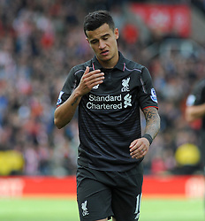 Liverpool's Philippe Coutinho cuts a dejected figure after the final whistle is blown - Photo mandatory by-line: Nizaam Jones/JMP - Mobile: 07966 386802 - 24/05/2015 - SPORT - Football - Stoke - Britannia Stadium - Stoke City v Liverpool - Barclays Premier League