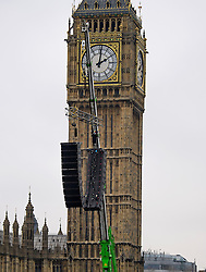 © Licensed to London News Pictures. 31/12/2016. London, UK. A speaker system hanging in place in front of The Houses of Parliament in Westminster Bridge London ahead of tonight's New Year celebrations. Security surrounding this year's event has been heightened following a terrorist attack at a Christmas market in Berlin earlier this month. Photo credit: Ben Cawthra/LNP