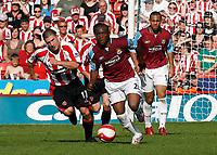 Photo: Paul Greenwood.<br />Sheffield United v West Ham United. The Barclays Premiership. 14/04/2007. West Ham's Nigel Reo-Coker (L) runs away from Nick Montgomery