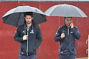 Rain Stops Play - Tim Groenewald of Somerset and Lewis Gregory of Somerset walking through the car park with umbrellas as the rain continues to fall during the Specsavers County Champ Div 1 match between Somerset County Cricket Club and Essex County Cricket Club at the Cooper Associates County Ground, Taunton, United Kingdom on 23 September 2019.