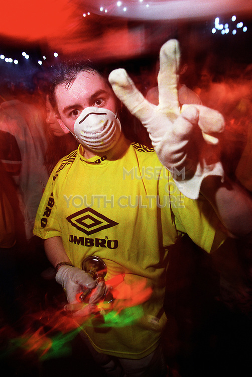 Guy giving the peace sign at a rave, Slammin Vinyl, Bagleys 1998