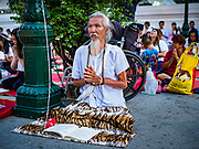 31 DECEMBER 2018 - BANGKOK, THAILAND: A man prays during New Year's Eve prayers and meditation at Wat Pathum Wanaram in central Bangkok. Many Thais go to temples to meditate and pray on New Year's Eve.    PHOTO BY JACK KURTZ