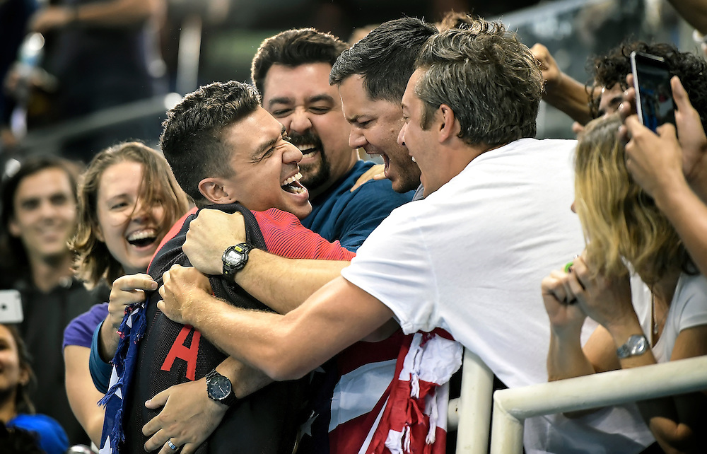 United States swimmer Anthony Ervin greeted his friends in the stands after the medal ceremonies for his gold medal in the men's 50m freestyle final on Friday at the Olympic Aquatic Stadium during the 2016 Summer Olympics Games in Rio de Janeiro, Brazil.