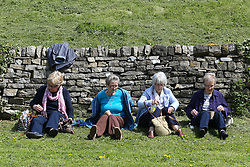 © Licensed to London News Pictures. 05/05/2016. Tissington, UK.  Day  trippers enjoy the bright warm sunshine in the Derbyshire village of Tissington. Britain is set to see a heatwave this weekend with temperatures reaching the mid twenties. Photo credit : Ian Hinchliffe/LNP