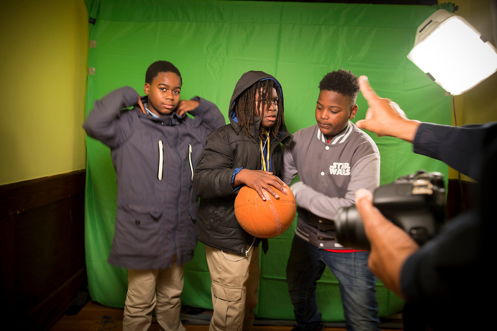 NOVEMBER, 16, 2017 - NOVEMBER, 16, 2017 - NORTH CHARLESTON, S.C.- Local photographer Douglass Carr Cunningham, right, poses a group of student in a photo studio at Metanoia. Instructors use the art of photography to teach students about the fundamentals of a small business. (BNG/Stephen B. Morton)