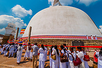 Ruwanwelisaya Dagoba (Stupa) in the ancient city of Anuradhapura, Sri Lanka. Also known as the Ruwanweli Maha Seya, or Great Stupa is a sacred place of pilgrimage and worship in the ancient city of Anuradhapura.