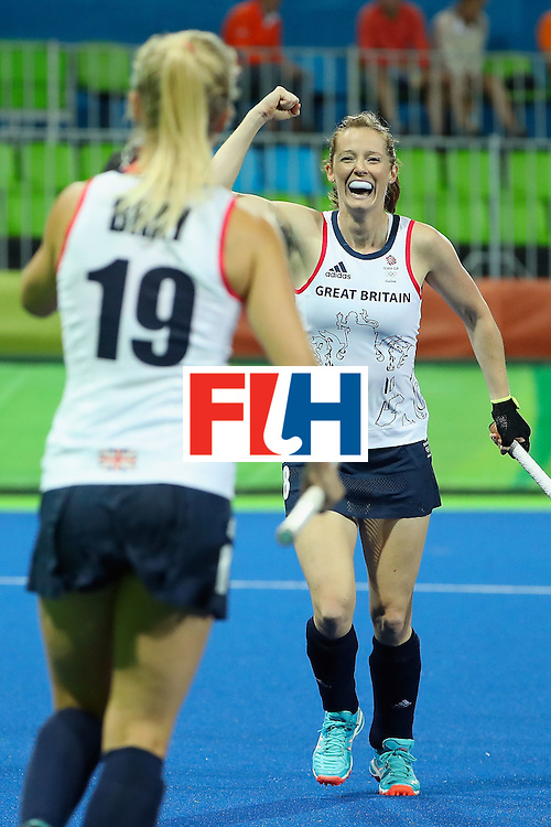RIO DE JANEIRO, BRAZIL - AUGUST 15:  Helen Richardson-Walsh #8 (R) of Great Britain celebrates with Sophie Bray #19 after Richardson-Walsh scored a first half goal against Spain during the quarter final hockey game on Day 10 of the Rio 2016 Olympic Games at the Olympic Hockey Centre on August 15, 2016 in Rio de Janeiro, Brazil.  (Photo by Christian Petersen/Getty Images)