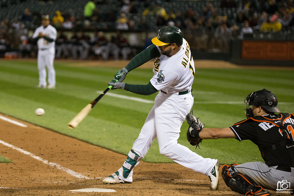 Oakland Athletics first baseman Yonder Alonso (17) makes contact with a Miami Marlins pitch at Oakland Coliseum in Oakland, Calif., on May 23, 2017. (Stan Olszewski/Special to S.F. Examiner)