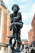 Fountain sculpture in front of St Mary's church in St Mary's square, Krakow, Poland