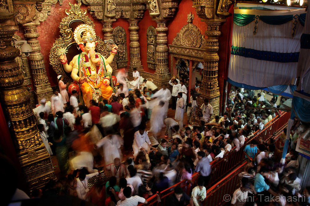 Hindu devotees worship the Lalbaugcha Raja, one of the most popular ganesha idles in Mumbai, India on Sep 11, 2010 on the first day of Ganpati festival. The 10-day hindu festival, celebrating the birthday of Lord Ganesha who is widely worshiped as the god of wisdom, prosperity and good fortune, attracts tens of thousands people..Photo by Kuni Takahashi
