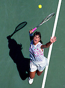 Jennifer Capriati takes aim to serve at the US Open Tennis Tournament in Flushing, N.Y.